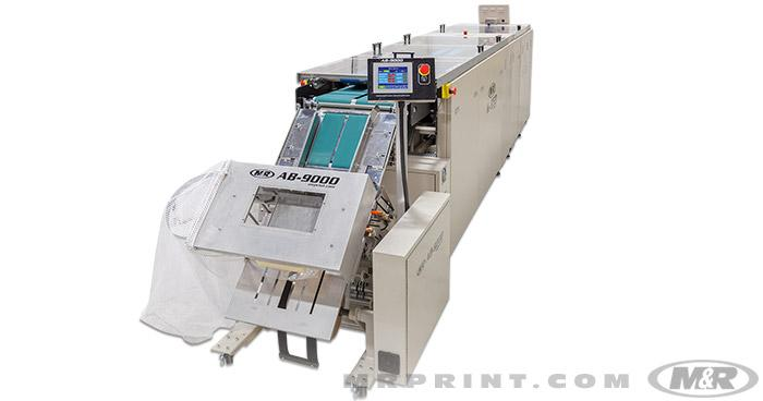 AB-9000 Automatic Bagging & Sealing Machine shown attached to the K-950 Automatic Shirt Folder